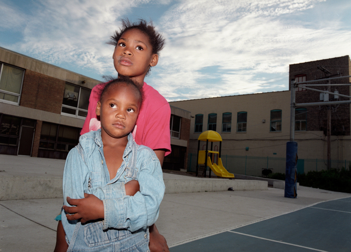 Two girls at basketball tournament at Harold Ikes Homes housing project, Chicago, Illinois, 2000