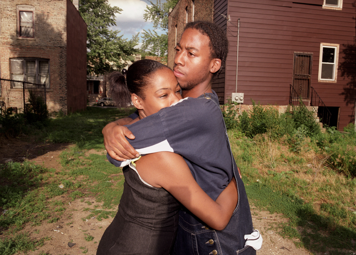 Couple embraces in yard near scene of domestic violence incident, Chicago, Illinois, 2000
