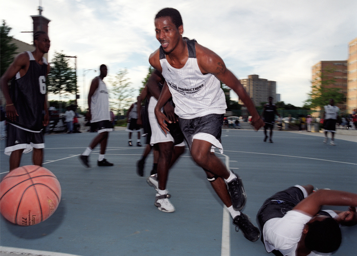 Basketball player in tournament at Harold Ickes Homes housing project, Chicago, Illinois, 2000
