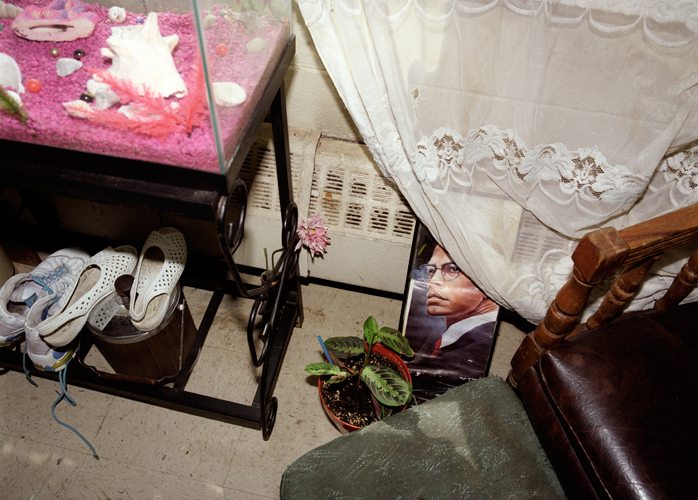 Living room in apartment inhabited by Peggy White for 16 years on 17th floor of Stateway Gardens housing project before evacuation, Chicago, Illinois, 2000