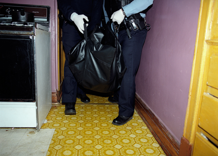 Officers transport body of deceased 83 year-old man found in bathroom of his home, Chicago, Illinois, 2000